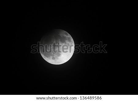 Partial Lunar eclipse on 25 April 2013 at 23:00:33, Bahrain - stock photo