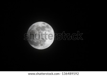 Partial Lunar eclipse on 25 April 2013 at 21:53:42, Bahrain - stock photo