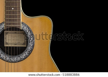 Partial of acoustic guitar isolated on black background