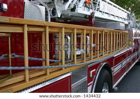 Partial profile of a fire truck - stock photo