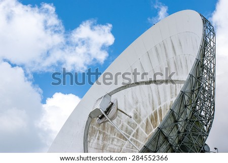 Partial view of a satellite dish for intercontinental telecommunications and Internet traffic - stock photo