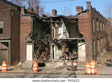 Partially demolished building. - stock photo