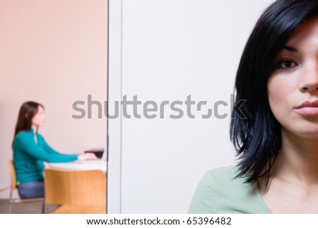 Partially obscured woman - stock photo