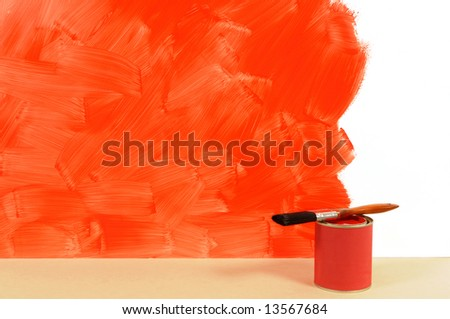 Partly finished blank red painted wall with paint can and paintbrushes.  Space for copy. - stock photo