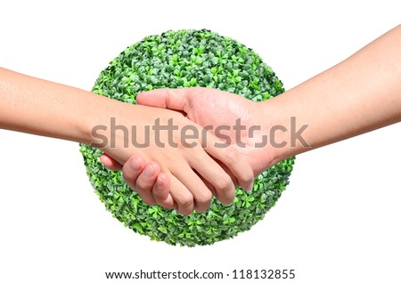 Partner hand between a man and a woman on green planet world in signal of protection and conservation