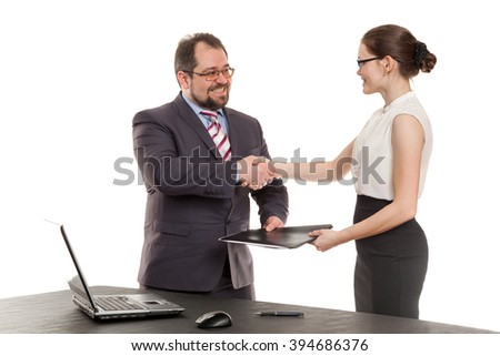 partners shake hands each other before a table