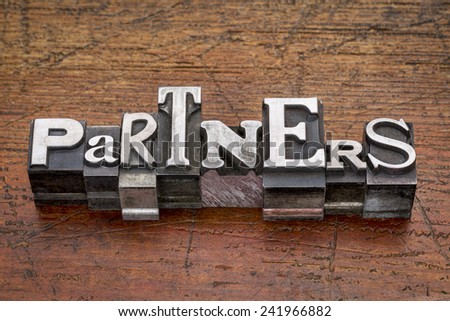 partners word in mixed vintage metal type printing blocks over grunge wood - stock photo