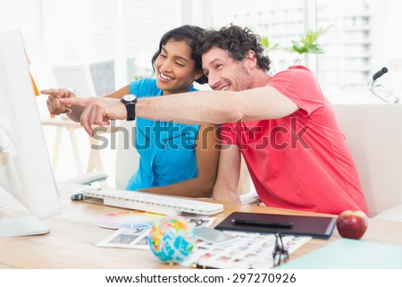 partners working together on tablet in the office - stock photo