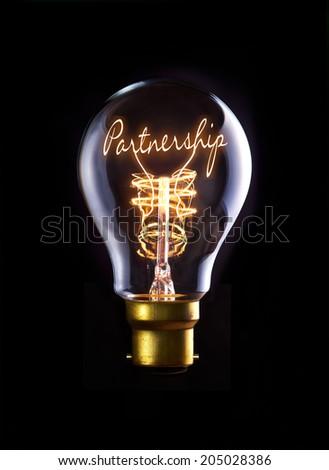 Partnership concept in a filament lightbulb. - stock photo