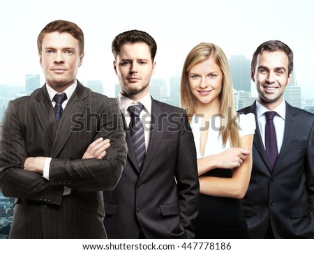 Partnership concept with attractive white businessmen and woman on city background - stock photo