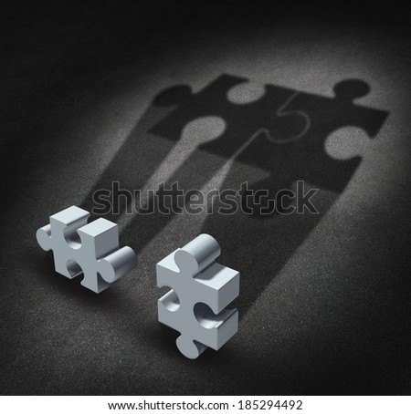 Partnership vision business concept as two jigsaw puzzle pieces casting shadows to bring the symbols together as a team united as a metaphor for partner agreement and working together for success. - stock photo