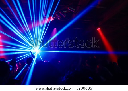 Party at Disco and laser show - stock photo