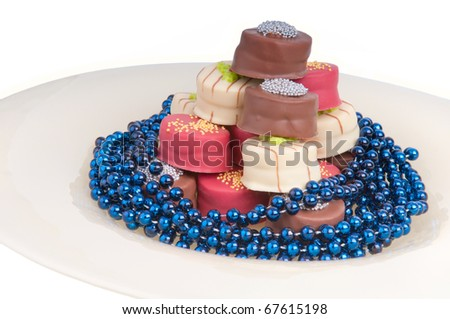 party chocolates on a glass plate - stock photo