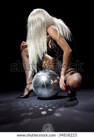 party dancer girl in fishnet stockings with disco ball