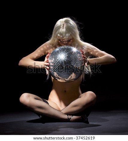 party dancer girl in fishnet stockings with disco ball - stock photo