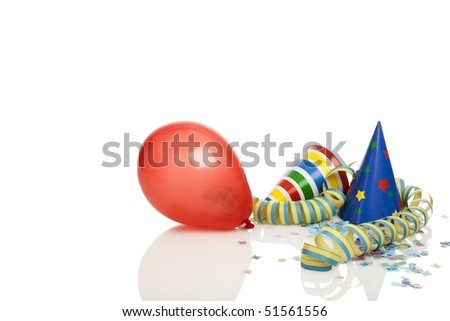 party decoration -  balloon, streamer, confetti, party hats isolated on white, copy space top and left - stock photo