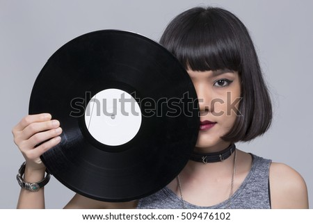 Party DJ, Nightclub, Music,Portrait of asian woman DJ with vinyl record  .