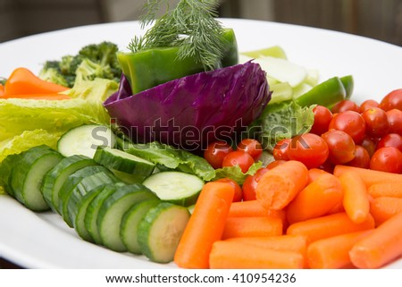 Party food featuring a platter of colorful, fresh vegetables - stock photo