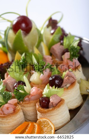 Party food on a silver platter - stock photo