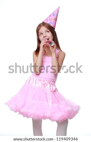 Party girl in lovely pink top and adorable pink tutu with fife and holiday hat isolated on white background