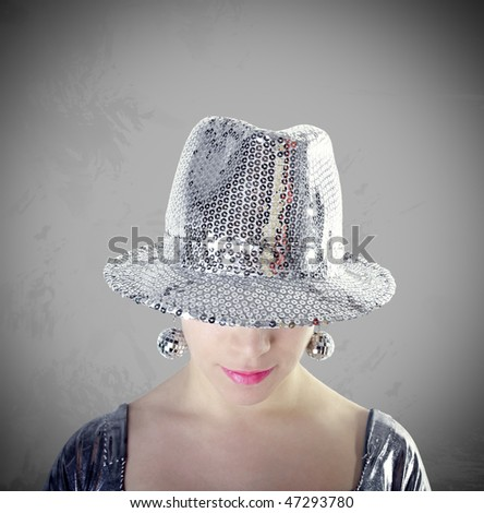 Party girl with silver hat portrait with grunge gray background - stock photo