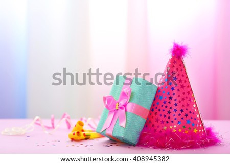 Party hat on bright background - stock photo