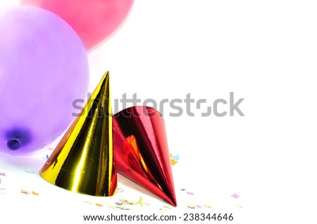 Party hats and balloons - stock photo