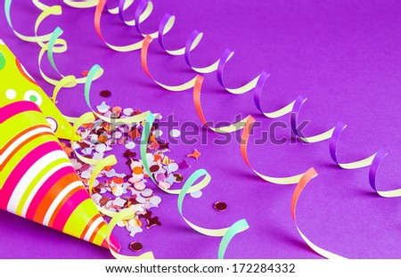 Party hats and streamers - stock photo