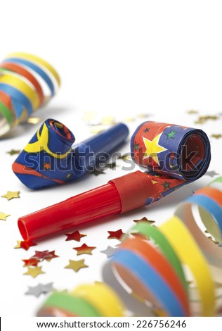 Party horn blower on white - stock photo