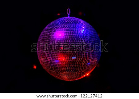 Party light disco ball on dark background