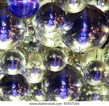 Party lights disco ball at a nightclub - stock photo