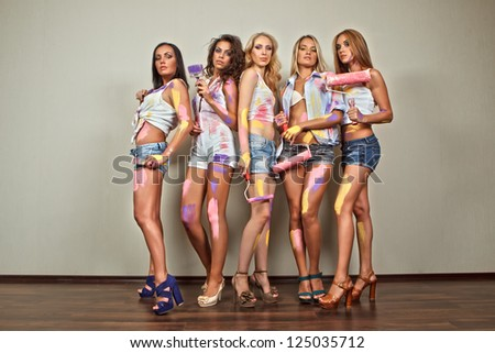 Party of cheerful young painting  women with brushes - stock photo