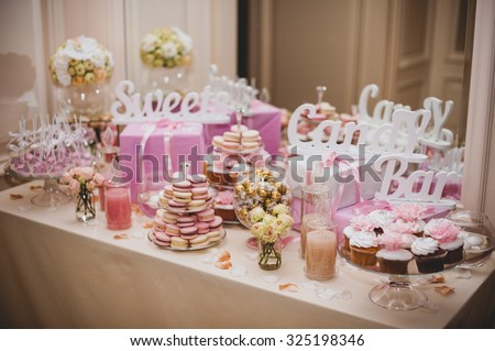 party reception, decorated desert table pink color - stock photo