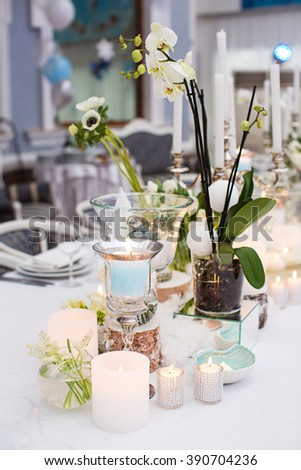 party table decoration with flowers and candles