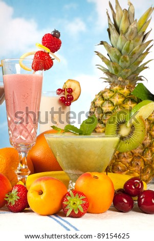 Party table with summer fruits and colorful smoothies - stock photo