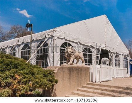 Party Tent or a big white banquet wedding tent for ceremonies - stock photo