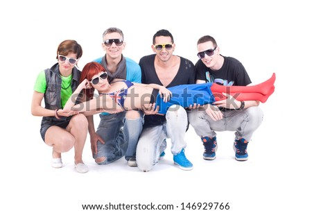 Party time. Four friends hold a Disco girl. Studio shot - stock photo