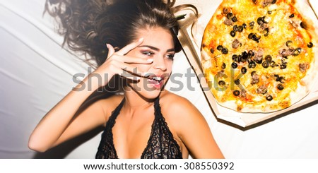 Party time,happy mood,positive emotions,laughing teenage girl.Happy woman holding tasty piece of spicy pizza with cheese.waiting for friends at home,han-party,pajama party,girls holiday,laughing,smile - stock photo