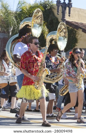 PASADENA, CA - JANUARY 18 : A Pasadena high-school band marches at the Doo Dah Parade on January 18, 2009 in Pasadena. The parade is a parody of Pasadena's more famous Rose Parade. - stock photo