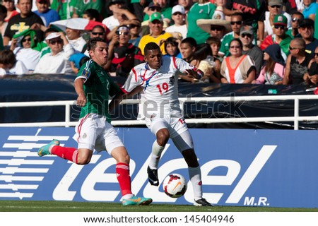 PASADENA, CA - JULY 7: Alberto Quintero #19 of Panama and Israel Jimenez #2 of Mexico during the 2013 CONCACAF Gold Cup game between Mexico and Panama on July 7, 2013 at the Rose Bowl in Pasadena, Ca. - stock photo