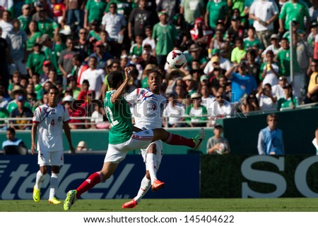 PASADENA, CA - JULY 7: Alejandro Castro #22 of Mexico and Gabriel Torres #9 of Panama in action during the 2013 CONCACAF Gold Cup game between Mexico and Panama on July 7, 2013 at the Rose Bowl. - stock photo