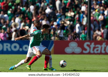 PASADENA, CA - JULY 7: Efrain Velarde #15 of Mexico and Gabriel Gomez #6 of Panama during the 2013 CONCACAF Gold Cup game between Mexico and Panama on July 7, 2013 at the Rose Bowl in Pasadena, Ca. - stock photo