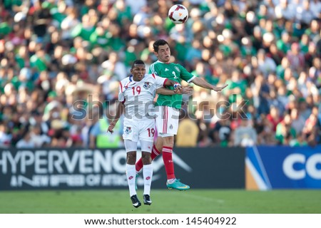 PASADENA, CA - JULY 7: Israel Jimenez #2 of Mexico and Alberto Quintero #19 of Panama during the 2013 CONCACAF Gold Cup game between Mexico and Panama on July 7, 2013 at the Rose Bowl in Pasadena, Ca. - stock photo