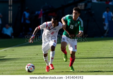 PASADENA, CA - JULY 7: Marcos Sanchez #8 of Panama and Efrain Velarde  #15 of Mexico during the 2013 CONCACAF Gold Cup game between Mexico and Panama on July 7, 2013 at the Rose Bowl in Pasadena, Ca. - stock photo