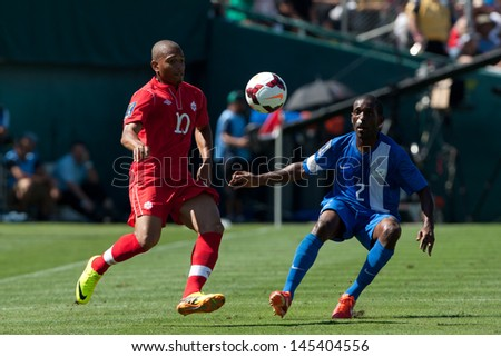 PASADENA, CA - JULY 7: Simeon Jackson #10 of Canada & Nicolas Zaire #2 of Martinique during the 2013 CONCACAF Gold Cup game between Canada & Martinique on July 7, 2013 at the Rose Bowl in Pasadena, Ca - stock photo