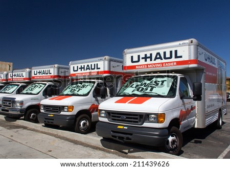 PASADENA, CA/USA - AUGUST 16, 2014. U-Haul trucks lined up in a row. U-Haul is a moving equipment and storage rental company based in Phoenix, Arizona.
