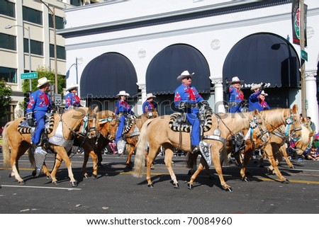 PASADENA, CA/USA - JANUARY 1: Long beach mounted police riders at the 122nd tournament of roses Rose Parade on January 1, 2011 in Pasadena California - stock photo