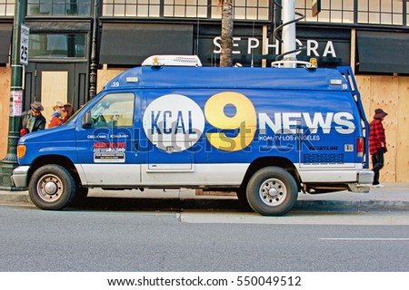 PASADENA/CALIFORNIA - JAN. 1, 2017: KCAL Channel 9 News Van with raised antenna is parked along Colorado Blvd. on New Years Day in Pasadena, California USA