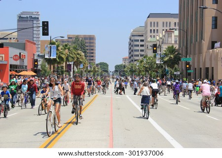 Pasadena, California, USA - May 31, 2015: CicLAvia is an event held in Los Angeles where streets are closed to motor vehicles and open for the public to walk, bike and skate through open streets. - stock photo