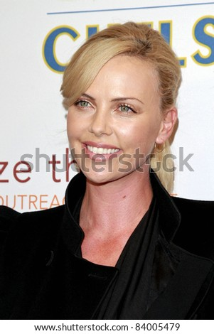 PASADENA - JULY 21: Charlize Theron at the World Football Challenge match between Chelsea FC and Inter Milan at the Rose Bowl in Pasadena, California on July 21, 2009 - stock photo